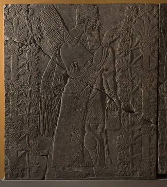 Assyrian. <em>Apkallu-figure Fertilizing the Sacred Tree</em>, ca. 883-859 B.C.E. Gypsum stone, 90 1/2 x 78 15/16 in. (229.8 x 200.5 cm). Brooklyn Museum, Purchased with funds given by Hagop Kevorkian and the Kevorkian Foundation, 55.151. Creative Commons-BY (Photo: Brooklyn Museum, 55.151_at_PS11.jpg)
