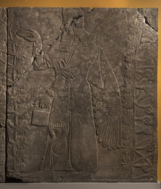 Assyrian. <em>Apkallu-figure Fertilizing the Sacred Tree</em>, ca. 883-859 B.C.E. Alabaster, 90 1/4 x 79 1/8 in. (229.2 x 201 cm). Brooklyn Museum, Purchased with funds given by Hagop Kevorkian and the Kevorkian Foundation, 55.152. Creative Commons-BY (Photo: Brooklyn Museum, 55.152_PS11.jpg)