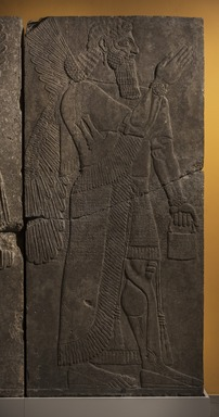 Assyrian. <em>Apkallu-figure</em>, ca. 883-859 B.C.E. Alabaster, 90 9/16 x 42 1/4 in. (230 x 107.3 cm). Brooklyn Museum, Purchased with funds given by Hagop Kevorkian and the Kevorkian Foundation, 55.154. Creative Commons-BY (Photo: Brooklyn Museum, 55.154_PS11.jpg)