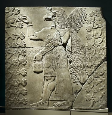 Assyrian. <em>Eagle-Headed Genie Between Two Sacred Trees</em>, ca. 883-859 B.C.E. Alabaster, 84 13/16 x 83 1/8 in. (215.5 x 211.2 cm). Brooklyn Museum, Purchased with funds given by Hagop Kevorkian and the Kevorkian Foundation, 55.156. Creative Commons-BY (Photo: Brooklyn Museum, 55.156_PS2.jpg)