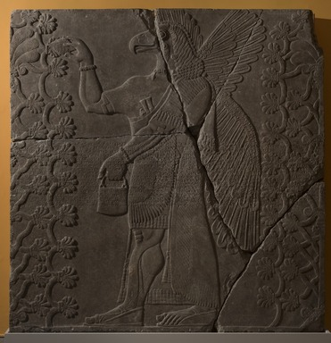 Assyrian. <em>Apkallu-figure Between Two Sacred Trees</em>, ca. 883-859 B.C.E. Gypsum stone, pigment, 84 13/16 x 83 1/8 in. (215.5 x 211.2 cm). Brooklyn Museum, Purchased with funds given by Hagop Kevorkian and the Kevorkian Foundation, 55.156. Creative Commons-BY (Photo: Brooklyn Museum, 55.156_at_PS11.jpg)