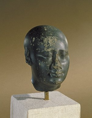 <em>Idealized Head</em>, ca. 300 B.C.E. Basalt, 4 13/16 x 3 1/16 x 4 1/2 in. (12.3 x 7.7 x 11.5 cm). Brooklyn Museum, Charles Edwin Wilbour Fund, 55.178. Creative Commons-BY (Photo: Brooklyn Museum, 55.178_SL1.jpg)