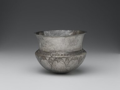 <em>Bowl with Incised Rosette on Base</em>, 400-200 B.C.E. Silver, 3 3/8 x 4 7/16 in., 0.6 lb. (8.5 x 11.3 cm, 0.3kg). Brooklyn Museum, Charles Edwin Wilbour Fund, 55.183. Creative Commons-BY (Photo: Brooklyn Museum, 55.183_view1_PS2.jpg)