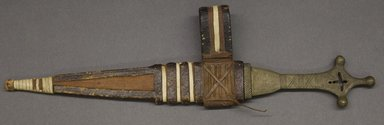 Tuareg or. <em>Dagger in Sheath</em>. Metal, leather, In sheath: 16 3/4 in. (42.5 cm). Brooklyn Museum, Gift of Abraham Lasky, 55.186.1a-b. Creative Commons-BY (Photo: Brooklyn Museum, 55.186.1a-b_PS10.jpg)