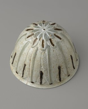<em>Molded Hemispherical Bowl</em>, 2nd-1st century B.C.E. Faience, 3 11/16 x Diam. 5 1/2 in. (9.4 x 14 cm). Brooklyn Museum, Charles Edwin Wilbour Fund, 55.1. Creative Commons-BY (Photo: Brooklyn Museum, 55.1_PS9.jpg)