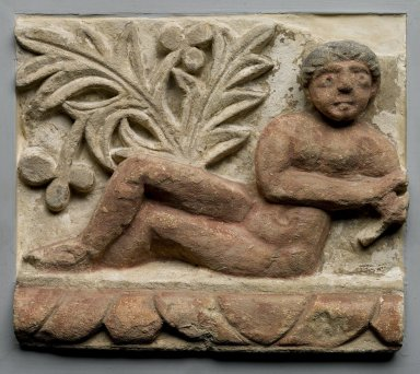 Coptic. <em>Frieze Fragment with Semi-Reclining Nude</em>, 4th-5th century C.E., with 20th century alterations. Limestone, pigment, 11 x 12 5/8 x 4 in. (28 x 32 x 10.2 cm)  . Brooklyn Museum, Charles Edwin Wilbour Fund, 55.2.2. Creative Commons-BY (Photo: Brooklyn Museum, 55.2.2_PS1.jpg)