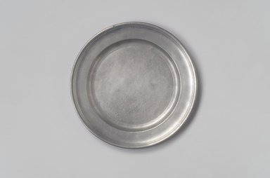 Edward Danforth (American). <em>Plate</em>, ca. 1790. Pewter, 5/8 x 8 x 8 in. (1.6 x 20.3 x 20.3 cm). Brooklyn Museum, Dick S. Ramsay Fund, 55.210. Creative Commons-BY (Photo: Brooklyn Museum, 55.210.jpg)