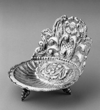 <em>Holy Water Dish</em>. Metal; silver, 4 x 4 1/2 x 3 3/4 in. Brooklyn Museum, Bequest of Charlotte R. Stillman, 55.36.1. Creative Commons-BY (Photo: Brooklyn Museum, 55.36.1_threequarter_left_bw.jpg)