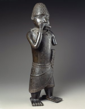 Edo. <em>Figure of a Hornblower</em>, ca. 1504-50. Copper alloy, iron, 24 1/2 x 8 1/2 x 6 in. (62.2 x 21.6 x 15.2 cm). Brooklyn Museum, Gift of Mr. and Mrs. Alastair B. Martin, the Guennol Collection, 55.87. Creative Commons-BY (Photo: Brooklyn Museum, 55.87_view2_SL4.jpg)