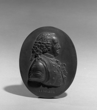 Wedgwood & Bentley (1768-1780). <em>Portrait Medallion</em>, ca.1775. Basaltes, 3 1/8 x 2 1/8 in. (7.9 x 5.4 cm). Brooklyn Museum, Gift of Emily Winthrop Miles, 55.9.10. Creative Commons-BY (Photo: Brooklyn Museum, 55.9.10_acetate_bw.jpg)