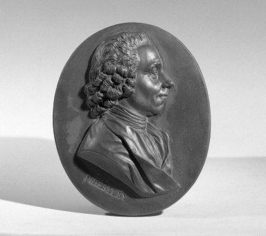 Wedgwood & Bentley (1768-1780). <em>Portrait Medallion</em>, 1775-1780. Basaltes, 3 1/4 x 2 1/2 in. (8.3 x 6.4 cm). Brooklyn Museum, Gift of Emily Winthrop Miles, 55.9.11. Creative Commons-BY (Photo: Brooklyn Museum, 55.9.11_acetate_bw.jpg)