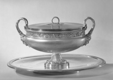 Henry Auguste. <em>Tureen with Cover on Tray</em>, ca. 1800. Silver, 10 7/8 x 10 1/2 x 18 in. (27.6 x 26.7 x 45.7 cm) Tureen. Brooklyn Museum, Gift of James H. Hyde, 56.176a-c. Creative Commons-BY (Photo: Brooklyn Museum, 56.176a-c_acetate_bw.jpg)