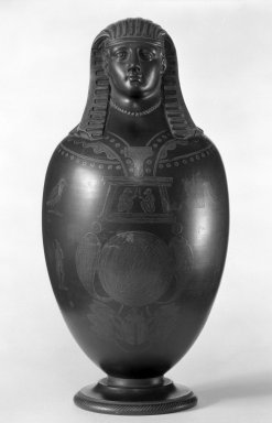 Wedgwood & Bentley (1768-1780). <em>Canopic Vase</em>, ca. 1780. Wedgwood and other black basalt, 13 5/8 x 5 1/2 in. (34.6 x 14 cm). Brooklyn Museum, Gift of Emily Winthrop Miles, 56.192.34. Creative Commons-BY (Photo: Brooklyn Museum, 56.192.34_bw.jpg)