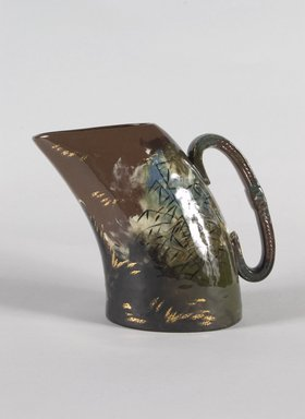 Clara C. Newton (American, 1848-1936). <em>Pitcher</em>, 1882. Glazed earthenware, 6 1/2 x 3 3/4 x 2 1/8 in.  (16.5 x 9.5 x 5.4 cm). Brooklyn Museum, Gift of J. Ethel Brown, 56.32. Creative Commons-BY (Photo: Brooklyn Museum, 56.32_PS5.jpg)