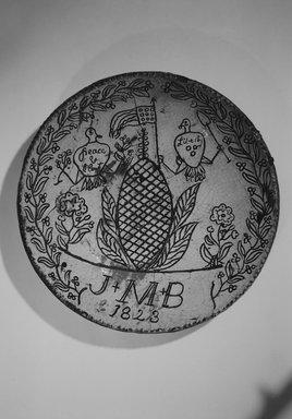 American. <em>Pie Plate</em>, 1823. Earthenware, 2 3/8 x 12 1/4 x 12 1/4 in. (6 x 31.1 x 31.1 cm). Brooklyn Museum, Gift of Huldah Cail Lorimer in memory of George Burford Lorimer, 56.5.11. Creative Commons-BY (Photo: Brooklyn Museum, 56.5.11_bw.jpg)