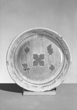 American. <em>Dish</em>, 1786. Earthenware, 1 3/4 x 11 1/8 in. (4.4 x 28.3 cm). Brooklyn Museum, Gift of Huldah Cail Lorimer in memory of George Burford Lorimer, 56.5.12. Creative Commons-BY (Photo: Brooklyn Museum, 56.5.12_acetate_bw.jpg)