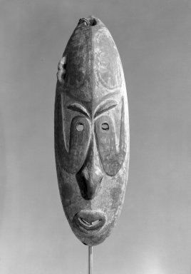 <em>Carved Mask</em>. Wood, 20 9/16 x 6 7/16 in.  (52.2 x 16.3 cm). Brooklyn Museum, Gift of Arturo and Paul Peralta-Ramos, 56.6.14. Creative Commons-BY (Photo: Brooklyn Museum, 56.6.14_acetate_bw.jpg)