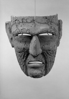 <em>Carved Mask</em>. Wood, 10 1/2 x 8 15/16 in.  (26.7 x 22.7 cm). Brooklyn Museum, Gift of Arturo and Paul Peralta-Ramos, 56.6.17. Creative Commons-BY (Photo: Brooklyn Museum, 56.6.17_acetate_bw.jpg)