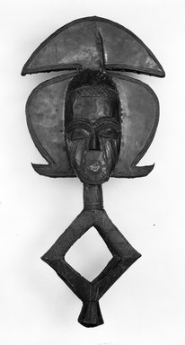 Kota (Ndassa subgroup). <em>Reliquary Guardian Figure (Mbulu Viti)</em>, late 19th-early 20th century. Wood, copper, copper alloy, iron, 24 13/16 x 12 3/16 x 4 in. (63.0 x 31.0 x 10.1 cm). Brooklyn Museum, Gift of Arturo and Paul Peralta-Ramos, 56.6.20. Creative Commons-BY (Photo: Brooklyn Museum, 56.6.20_bw.jpg)