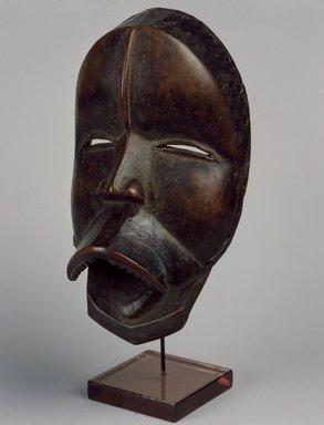 Dan. <em>Mask</em>, late 19th or early 20th century. Wood, leather (replacement hinges), applied material, 9 3/4 x 5 1/2 x 4 in. (24.8 x 14 x 10.2 cm). Brooklyn Museum, Gift of Arturo and Paul Peralta-Ramos, 56.6.25. Creative Commons-BY (Photo: Brooklyn Museum, 56.6.25_SL3.jpg)