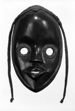 Dan. <em>Mask</em>, late 19th-early 20th century. Wood, fiber, resin, 10 1/4 x 5 5/8 in.  (26.0 x 14.3 cm). Brooklyn Museum, Gift of Arturo and Paul Peralta-Ramos, 56.6.26. Creative Commons-BY (Photo: Brooklyn Museum, 56.6.26_bw.jpg)