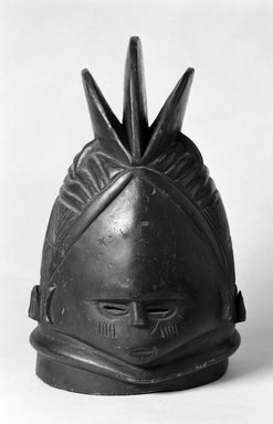 Mende. <em>Sande society mask (sowei)</em>, late 19th-early 20th century. Wood, pigment, 17 x 10 1/16 in.  (43.2 x 25.6 cm). Brooklyn Museum, Gift of Arturo and Paul Peralta-Ramos, 56.6.29. Creative Commons-BY (Photo: Brooklyn Museum, 56.6.29_bw.jpg)