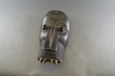 Dan. <em>Elephant Mask</em>, late 19th-early 20th century. Wood, pigment, iron, 13 x 6 3/4 x 6 1/4 in. (33 x 17.1 x 15.9 cm). Brooklyn Museum, Gift of Arturo and Paul Peralta-Ramos, 56.6.3. Creative Commons-BY (Photo: Brooklyn Museum, 56.6.3_front_PS5.jpg)