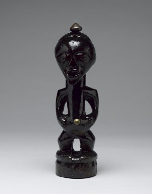 Songye. <em>Power Figure (Nkishi)</em>, late 19th or early 20th century. Wood, metal, organic materials, 8 1/2 x 2 1/4 in. (21.7 x 6.0 cm). Brooklyn Museum, Gift of Arturo and Paul Peralta-Ramos, 56.6.43. Creative Commons-BY (Photo: Brooklyn Museum, 56.6.43_front_PS6.jpg)