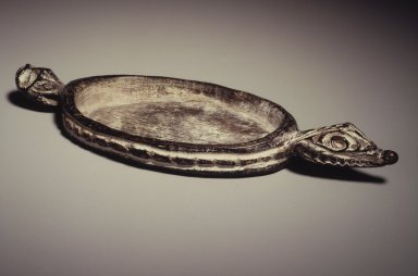 Iatmul. <em>Pigment Dish</em>, 20th century. Wood, pigment, 8 x 3 x 1 in. (20.3 x 7.6 x 2.5 cm). Brooklyn Museum, Gift of Arturo and Paul Peralta-Ramos, 56.6.48. Creative Commons-BY (Photo: Brooklyn Museum, 56.6.48.jpg)