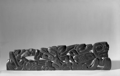 Possibly Haida. <em>Carved Pipe</em>, 1868-1933. Slate, argillite, 34.6 x 9.7 cm / 13 1/2 x 3 3/4 in. Brooklyn Museum, Gift of Arturo and Paul Peralta-Ramos, 56.6.61. Creative Commons-BY (Photo: Brooklyn Museum, 56.6.61_acetate_bw.jpg)