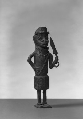 Edo. <em>Standing Male Figure</em>, 19th century. Copper alloy, 8 3/4 × 3 1/8 in. (22.2 × 8 cm). Brooklyn Museum, Gift of Arturo and Paul Peralta-Ramos, 56.6.67. Creative Commons-BY (Photo: Brooklyn Museum, 56.6.67_acetate_bw.jpg)