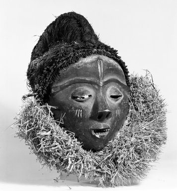 Pende (Western). <em>Mask (Mbuya)</em>, late 19th-early 20th century. Wood, pigment, fiber, raffia, 13 x 7 1/4 x 13 1/2 in. (33.0 x 18.4 x 34.3 cm). Brooklyn Museum, Gift of Arturo and Paul Peralta-Ramos, 56.6.6. Creative Commons-BY (Photo: Brooklyn Museum, 56.6.6_bw.jpg)