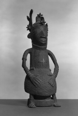 Edo. <em>Figure of an Oba</em>, 19th or 20th century. Copper alloy, 12 3/16 × 5 1/8 in. (31 × 13 cm). Brooklyn Museum, Gift of Arturo and Paul Peralta-Ramos, 56.6.71. Creative Commons-BY (Photo: Brooklyn Museum, 56.6.71_acetate_bw.jpg)