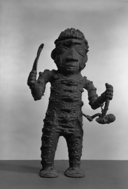 Edo. <em>Standing Executioner Figure</em>, 19th or 20th century. Copper alloy, 13 3/8 × 8 7/16 in. (34 × 21.5 cm). Brooklyn Museum, Gift of Arturo and Paul Peralta-Ramos, 56.6.77. Creative Commons-BY (Photo: Brooklyn Museum, 56.6.77_acetate_bw.jpg)