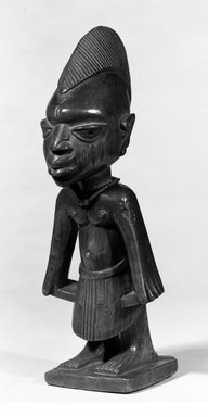 Yorùbá artist. <em>Male twin figure (Ère Ìbejì)</em>, late 19th or early 20th century. Wood, 10 3/8 x 4 in. (26.4 x 10.3 cm). Brooklyn Museum, Gift of Arturo and Paul Peralta-Ramos, 56.6.83. Creative Commons-BY (Photo: Brooklyn Museum, 56.6.83_threequarter_bw.jpg)