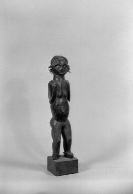 Ngbaka. <em>Figure of Standing Female</em>, late 19th-early 20th century. Wood, metal, plastic beads, 12 1/4 x 4 1/2 x 3 1/2 in. (54.0 x 11.7 x 8.2 cm). Brooklyn Museum, Gift of Arturo and Paul Peralta-Ramos, 56.6.85. Creative Commons-BY (Photo: Brooklyn Museum, 56.6.85_acetate_bw.jpg)