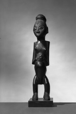 Sundi. <em>Figure of Standing Female</em>, 19th century. Wood, mud/resin? applied materials, 14 x 3 1/2 x 3 3/4 in. (35.6 x 9.0 x 9.5 cm). Brooklyn Museum, Gift of Arturo and Paul Peralta-Ramos, 56.6.86. Creative Commons-BY (Photo: Brooklyn Museum, 56.6.86_acetate_bw.jpg)