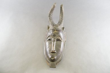 Baule. <em>Antelope Mask</em>, late 19th or early 20th century. Wood, pigment, 15 3/8 x 5 1/4 in.  (39.0 x 13.3 cm). Brooklyn Museum, Gift of Arturo and Paul Peralta-Ramos, 56.6.8. Creative Commons-BY (Photo: Brooklyn Museum, 56.6.8_front_PS5.jpg)