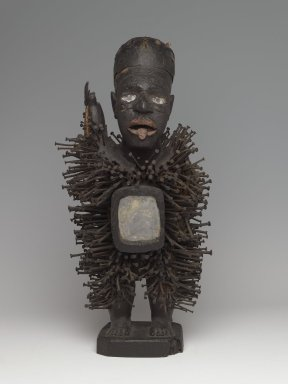 Kongo (Solongo or Woyo subgroup). <em>Power Figure (Nkisi Nkondi)</em>, late 19th-early 20th century. Wood, iron, glass, fiber, pigment, bone, 24 x 6 1/2 x 8 1/2 in. (61.5 x 17.0 x 21.5 cm). Brooklyn Museum, Gift of Arturo and Paul Peralta-Ramos, 56.6.98. Creative Commons-BY (Photo: Brooklyn Museum, 56.6.98_front_PS6.jpg)