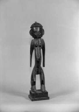 Ngbaka. <em>Figure of Standing Male (Seto)</em>, late 19th-early 20th century. Wood, 12 1/4 x 4 1/2 x 4 in. (54.0 x 11.7 x 10.0 cm). Brooklyn Museum, Gift of Arturo and Paul Peralta-Ramos, 56.6.99. Creative Commons-BY (Photo: Brooklyn Museum, 56.6.99_acetate_bw.jpg)