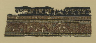 <em>Textile Fragment with Figural and Floral Motifs and Inscriptions</em>, 7th-8th century. Wool, linen, 8 7/8 x 26 7/8 in. (22.5 x 68.3 cm). Brooklyn Museum, Anonymous gift, 57.120.3. Creative Commons-BY (Photo: Brooklyn Museum, 57.120.3_PS1.jpg)
