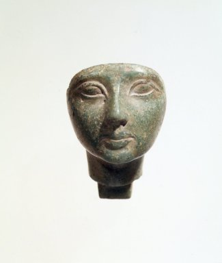 <em>Head of Woman</em>, ca. 1353-1075 B.C.E. Glass, 2 1/2 x 1 9/16 x 2 13/16 in. (6.4 x 4 x 7.1 cm). Brooklyn Museum, Charles Edwin Wilbour Fund, 57.164. Creative Commons-BY (Photo: Brooklyn Museum, 57.164_transpc003.jpg)