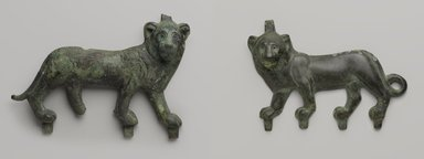 <em>Lion Applique</em>, 4th-3rd century B.C.E. Bronze, 5 5/8 x 8 1/8 in. (14.3 x 20.7 cm). Brooklyn Museum, Charles Edwin Wilbour Fund, 57.40. Creative Commons-BY (Photo: , 57.40_55.141_PS9.jpg)