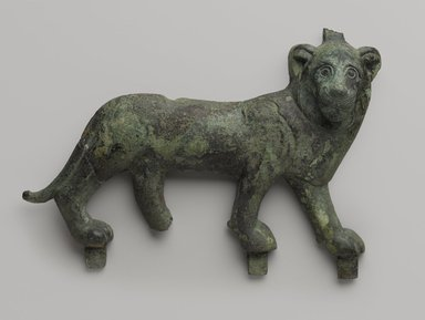 <em>Lion Applique</em>, 4th-3rd century B.C.E. Bronze, 5 5/8 x 8 1/8 in. (14.3 x 20.7 cm). Brooklyn Museum, Charles Edwin Wilbour Fund, 57.40. Creative Commons-BY (Photo: Brooklyn Museum, 57.40_PS9.jpg)