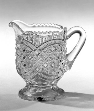 <em>Creamer</em>, ca. 1880. Pressed glass, 3 1/4 x 2 1/2 in. (8.3 x 6.4 cm). Brooklyn Museum, Gift of Mrs. Cheever Porter, 57.90.90. Creative Commons-BY (Photo: Brooklyn Museum, 57.90.90_bw.jpg)