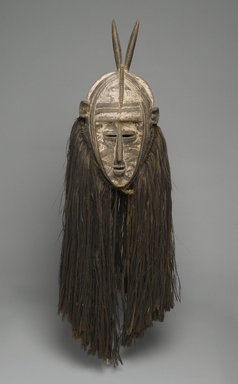 Bobo. <em>Bolo Mask</em>, early 20th cenutry. Wood, pigment, fiber, 45 1/2 x 14 x 13 in. (115.6 x 35.6 x 33 cm). Brooklyn Museum, Gift of Mr. and Mrs. Gustave Schindler, 58.184. Creative Commons-BY (Photo: Brooklyn Museum, 58.184_PS1.jpg)
