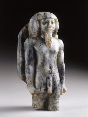 <em>Statuette of a Male Deity</em>, ca. 2500-2350 B.C.E. Gneiss, 8 3/8 x 3 5/8 in. (21.3 x 9.2 cm). Brooklyn Museum, Charles Edwin Wilbour Fund, 58.192. Creative Commons-BY (Photo: Brooklyn Museum, 58.192_threequarter_SL1.jpg)