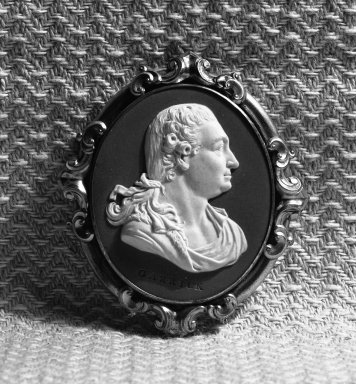 Wedgwood & Bentley (1768-1780). <em>Portrait Medallion</em>, ca. 1777. Jasperware, gilt, 2 3/4 x 2 1/2 in. (7 x 6.4 cm). Brooklyn Museum, Gift of Emily Winthrop Miles, 58.194.14. Creative Commons-BY (Photo: Brooklyn Museum, 58.194.14_acetate_bw.jpg)