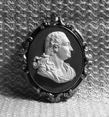 Wedgwood & Bentley (1768-1780). <em>Portrait Medallion</em>, ca. 1777. Jasperware, gilt, 2 3/4 x 2 1/2 in. (7 x 6.4 cm). Brooklyn Museum, Gift of Emily Winthrop Miles, 58.194.14. Creative Commons-BY (Photo: Brooklyn Museum, 58.194.14_acetate_bw.jpg)
