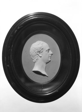 Josiah Wedgwood & Sons Ltd. (founded 1759). <em>Portrait Medallion</em>, ca. 1782. Jasperware, hardwood, 6 1/8 x 5 3/16 in. (15.6 x 13.2 cm) Frame. Brooklyn Museum, Gift of Emily Winthrop Miles, 58.194.31. Creative Commons-BY (Photo: Brooklyn Museum, 58.194.31_bw.jpg)